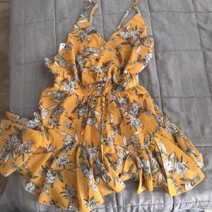 Yellow floral romper BRAND NEW